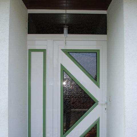 Fourniture et pose d'une porte d'entrée à UFFHOLTZ près de CERNAY en 2 couleurs