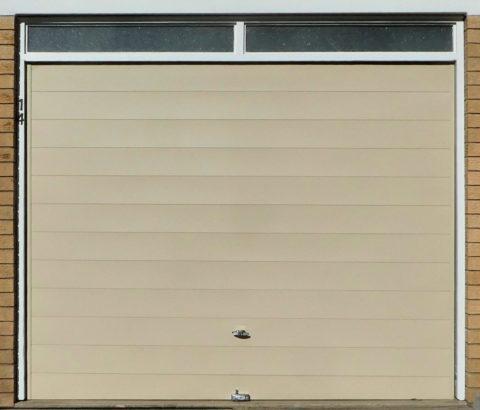 Comment fonctionne une porte de garage sectionnelle ?